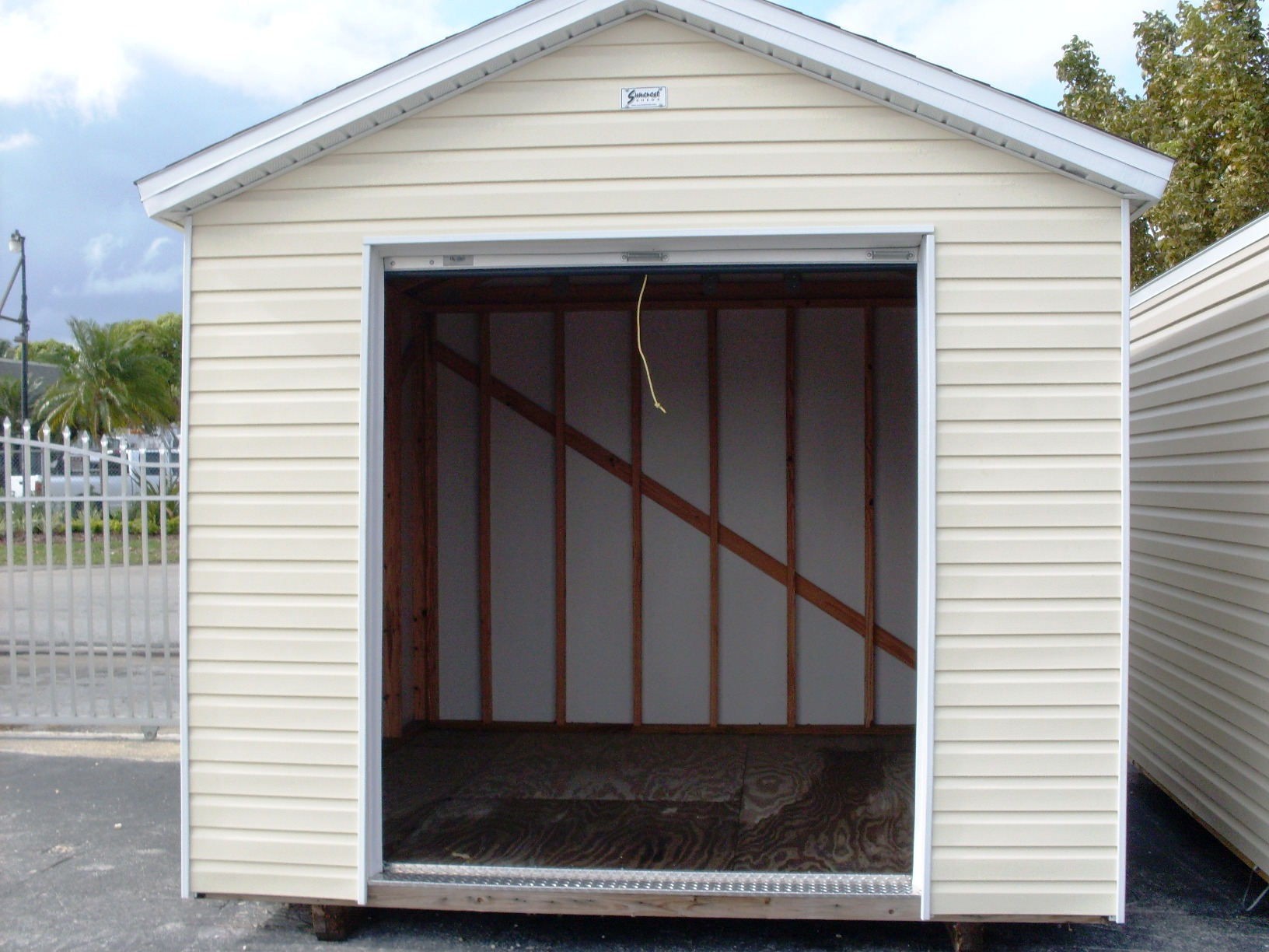 Garden home plans storage shed roll up door for Storage shed overhead door